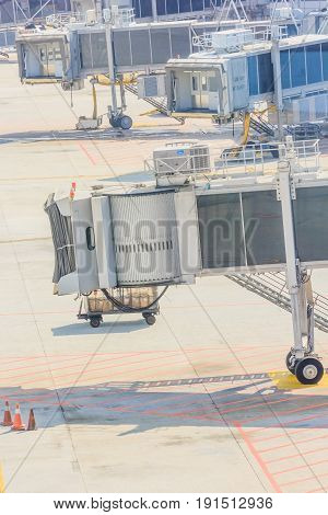 airplane Bridge in airport for passengers boarding or Jetway waiting for a plane to arrive on airport or airport terminal boarding gate.
