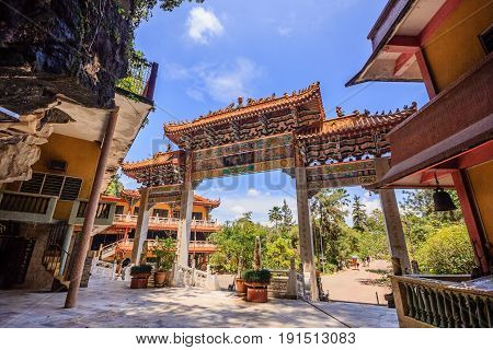 IPOH, PERAK, MALAYSIA - APRIL 14, 2017: Entrance view of the Sam Poh Tong Temple which is located at Gunung Rapat in the south of Ipoh.