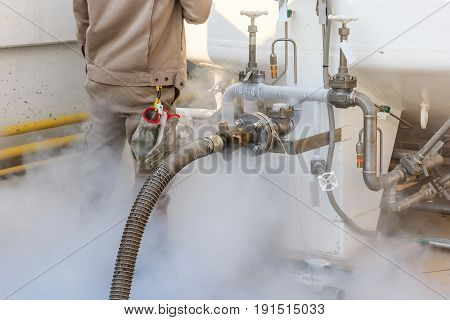 Worker loading liquid nitrogen with Nitrogen storage tank at new factory