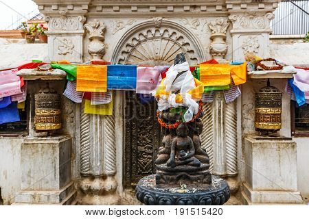 Statue of Buddha manifestations at the entrance to Boudhanath stupa