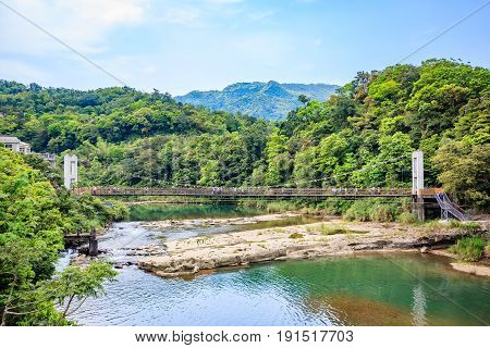Panoramic landscape near Shifen waterfall with a cable style bridge at Shifen New Taipei City Taiwan