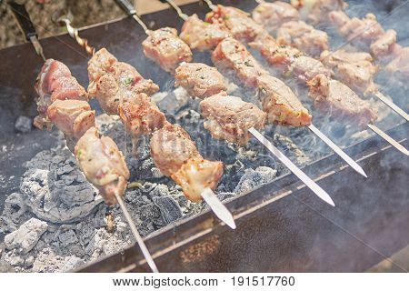 Pork Or Lamb Meat Pieces Being Fried On A Charcoal Grill