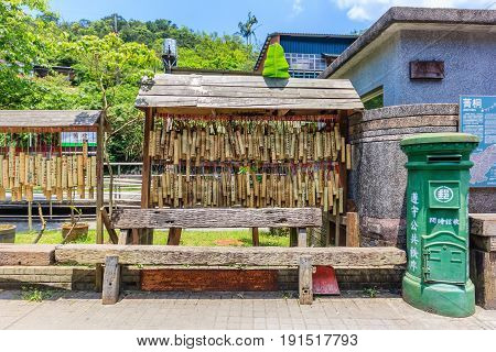 PINGXI, TAIWAN - APRIL 30, 2017: Bamboo Tube for Wishing at Pingxi Old Street. Visitors write their wishes on bamboos then pray and hang them together.