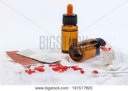 Fresh Bleeding Wounds Or Blood On Tissue Paper With First Aid Supplies, First Aid Equipment Or Emerg