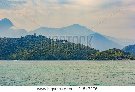 Beautiful Landscape of Sun Moon Lake in the morning with blue mountain background at Sun Moon Lake National Scenic Area Yuchi Township Nantou County Taiwan