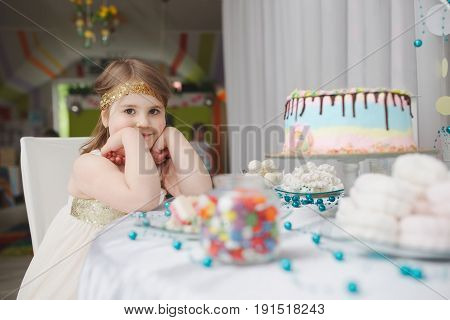 little girl with birthday cake at home