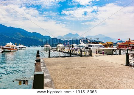 Boats parking at the pier at Sun Moon Lake Taiwan. Sun Moon Lake is the largest body of water in Taiwan as well as a tourist attraction.