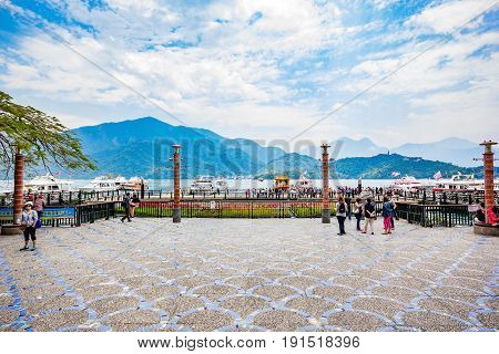 NANTOU, TAIWAN - APRIL 01, 2017: Tourists like to visit the beautiful attractions around the sun moon lake by boat cruise from Shuishe Pier to Ita Thao Pier and then to Xuanguang Temple Pier