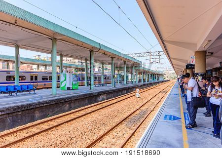 RUIFANG, TAIWAN - APRIL 30, 2017: Passengers are waiting in Ruifang railway station is a railway station on the Taiwan Railway Administration (TRA) Yilan Line New Taipei Taiwan.