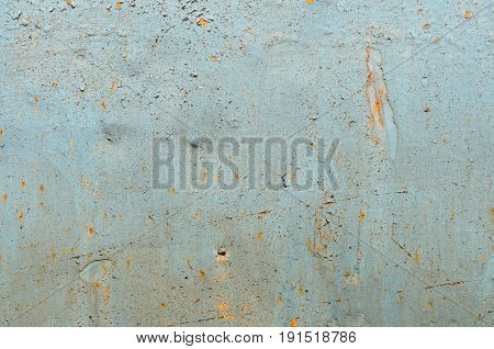 Cracked paint on old metal texture. Blue color. Rusted surface
