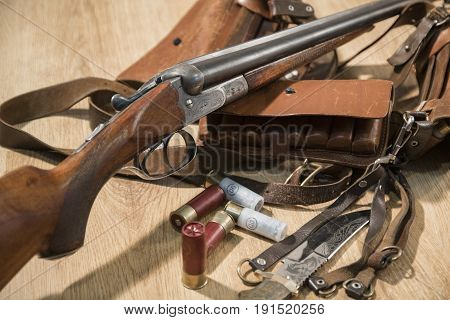 Double-barreled Shotgun, Bullets, Knife And Cartridge Belt