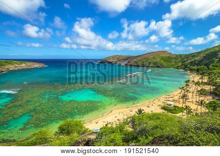 Aerial view of famous Hanauma Bay Nature Preserve with beach and coral reef in Oahu island, Hawaii, United States. Summer time leisure and water sports recreation. Nature scenic landscape.