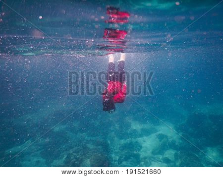 Asia Woman Wearing Red Shirt And Dive Goggle. She Diving Snorkeling Under Sea. This Image For Nature