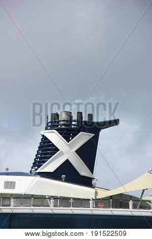 Velsen The Netherlands - June 9th 2017: Celebrity Eclipse - Celebrity Cruises on North Sea Channel detail of funnel
