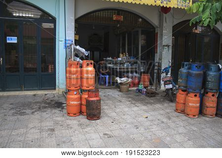 Gas Containers Seller At Market