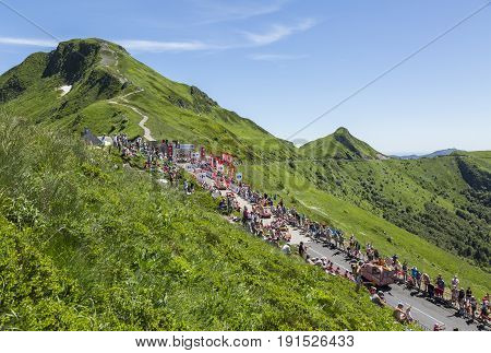 Pas de Peyrol, France - July 6, 2016: Cochonou Caravan during the passing of the Publicity Caravan on the road to Pas de Pyerol (Puy Mary) in the Central Massif during the stage 5 of Tour de France on July 6 2016.