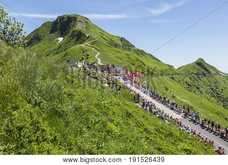 Pas de Peyrol, France - July 6, 2016: Crowds of fans waiting for the peloton on the side of the road to Pas de Pyerol (Puy Mary) in the Central Massif during the stage 5 of Tour de France on July 6 2016.