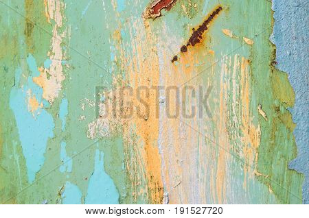 Yellow paint smears on a metal surface. Old metal texture for background