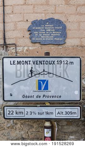 Bedoin France - 14 July 2017: Image of the road indicator located in Bedoin and signaling the start of one of the most famous cycling road in the world, the classical ascent from Bedoin to the top of Mont Ventoux.