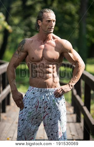 Man With Six Pack Outdoors In Nature