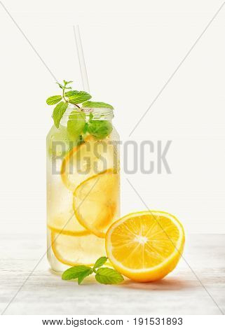 Lemonade With Fresh Citrus Lemon And Twig Mint With Drinking Straw On Wood Background