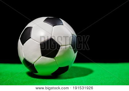 Soccer Ball On Green Grass Over Black Background, Close Up