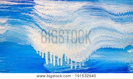 Acrylic stripe pattern with blue and white waves. Flowing paint.