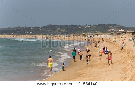 ALVOR, PORTUGAL - APRIL 23, 2017: People at the famous beach of Praia do Alvor, Algarve region, Portugal
