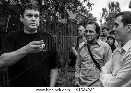 TOMSK, SIBERIA, RUSSIA - AUG 14, 2009: Vadim Kuzmin (left) (1964-2012) was a Russian musician, the leader of rock-band Chyorniy Lukich. From 1986, rock-band became part of Novosibirsk rock club.