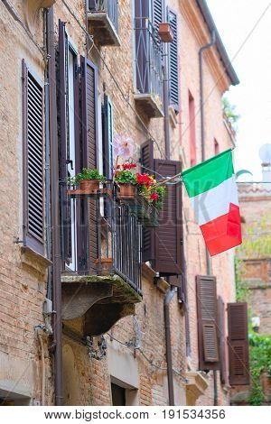 FERRARA, ITALY - June, 3, 2017: facade of an inhabitable house in Ferrara, Italy with Italian flag