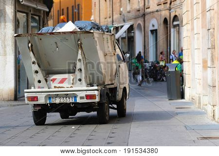 FERRARA, ITALY - June, 3, 2017: refuse truck in a center of Ferrara, Italy