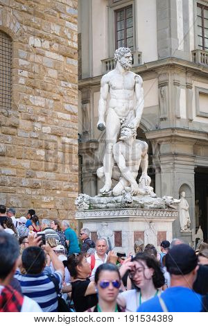 Florence, Italy - June, 5, 2017: visitors in Uffizi gallery yard in Florence, Italy near the sculptures of Michelangelo