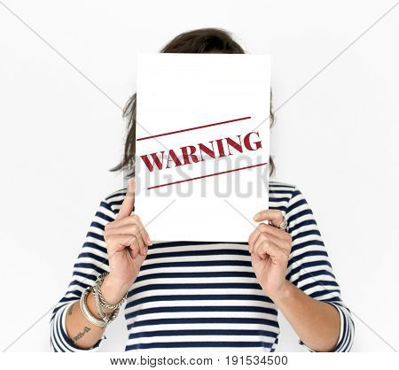 People hold caution alert concept card cover her face