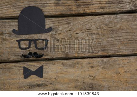 Overhead view of anthropomorphic face on wooden table