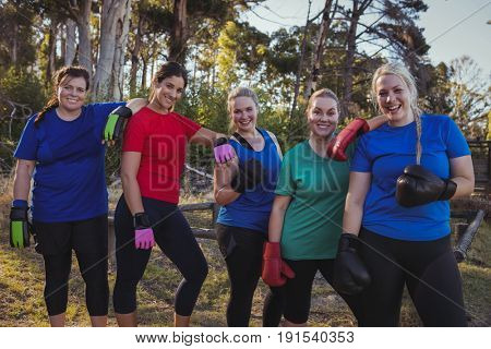 Group of fit women relaxing together in the boot camp on a sunny day