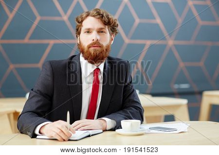 Business leader listening to one of applicants at interview