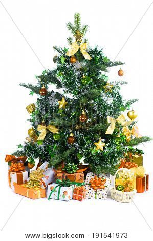 decorated Christmas tree with yellow heap of yellow gifts isolated on white background