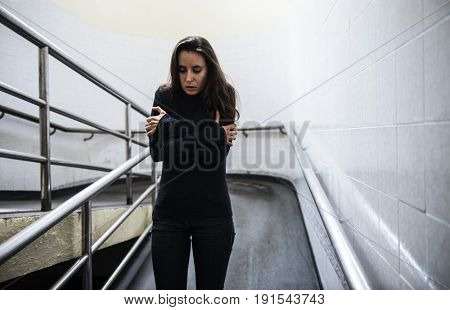 Cold Adult Woman Walk Hopeless Down the Ramp