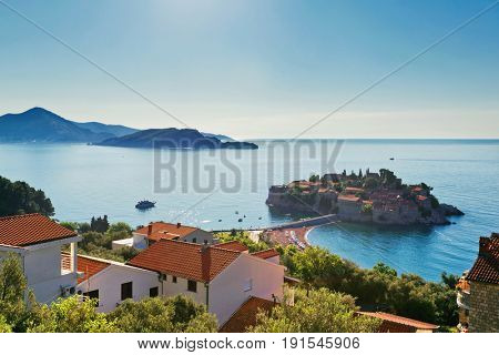 Sveti Stefan island in Budva in Island - architecture and nature background. Montenegro