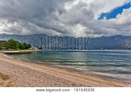 sea and mountains in bad cloudy weather. Montenegro