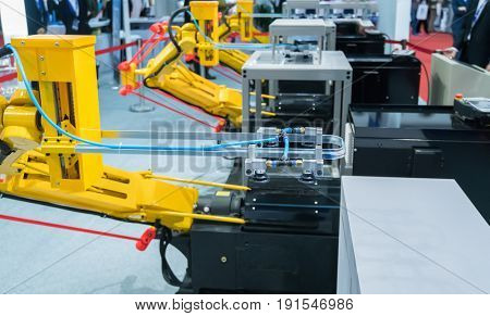 Industrial robot with vacuum suckers with conveyor in manufacture factory,Smart factory industry 4.0 concept