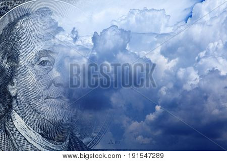 conceptual image of one hundred US dollar bill in cloudy sky