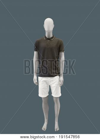 Full-length male mannequin in summer clothes isolated. No brand names or copyright objects.