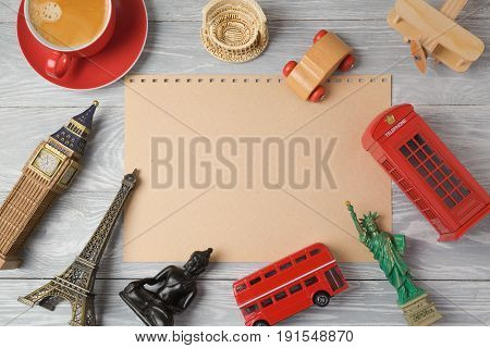 Travel and tourism concept with paper and souvenirs from around the world. View from above. Flat lay