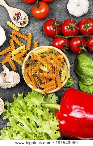 Fusilli Pasta With Spinach And Tomatoes, And Ingredients For Cooking (cherry Tomatoes, Spices, Garli