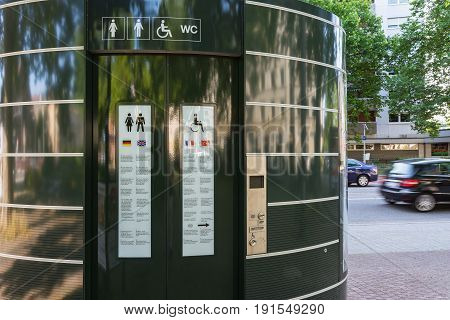 Outdoor City Paid Toilet Booth Single Utility Doors Closed Green