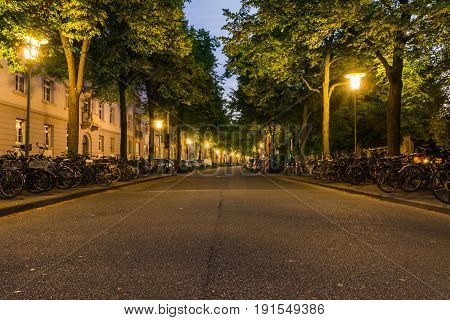 Sunrise over Street Across from Karlsruhe Train Station Lamps Dawn Sleepy Quiet Road