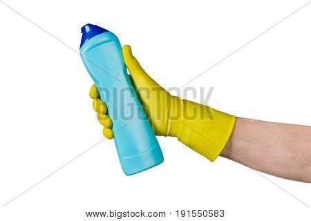 Male hand in yellow cleaning latex glove holding a bottle isolated on white background. Closeup photograph with copy space. Backdrop for advertising, packaging or concept.