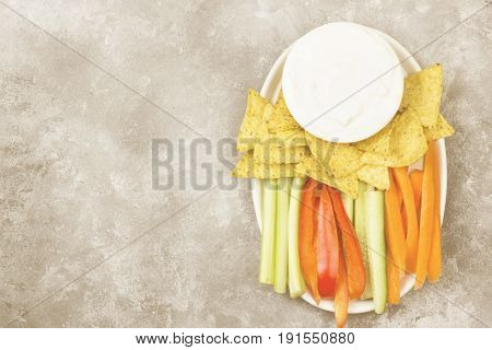 Creamy Sauce In White Bowl, Various Vegetables (celery, Pepper) And Nachos. Top View, Copy Space. Fo