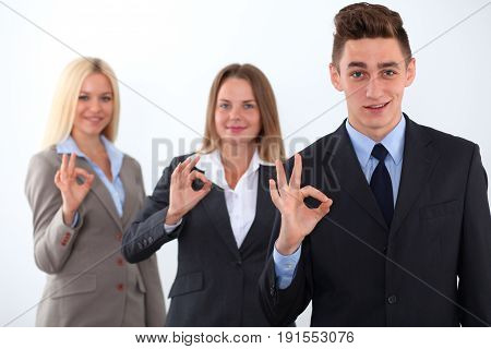 Group of business people, start-up team, ok hand sign
